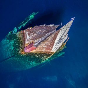 stunning drone image - abstract aerial photo - A sunken ship at Huemul Island