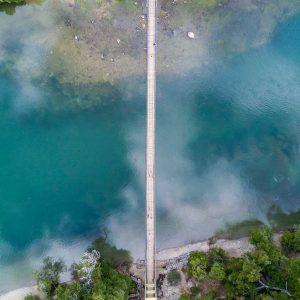 aerial river landscape abstract - aerial photos - aerial nature landscape - Pedestrian bridge over the Arrayanes River